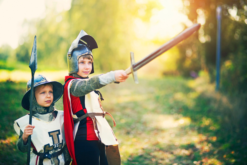 Two children dressed up as knights.