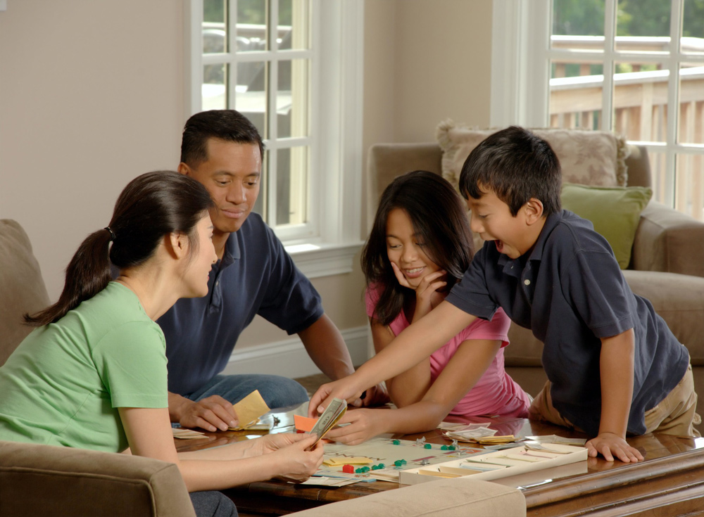 Family a playing board game togerher.