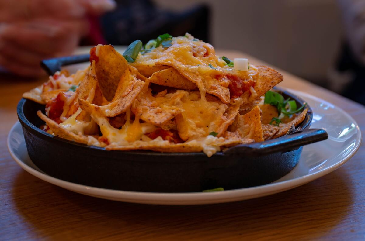 Nachos are great with cheese and a lot of fun.