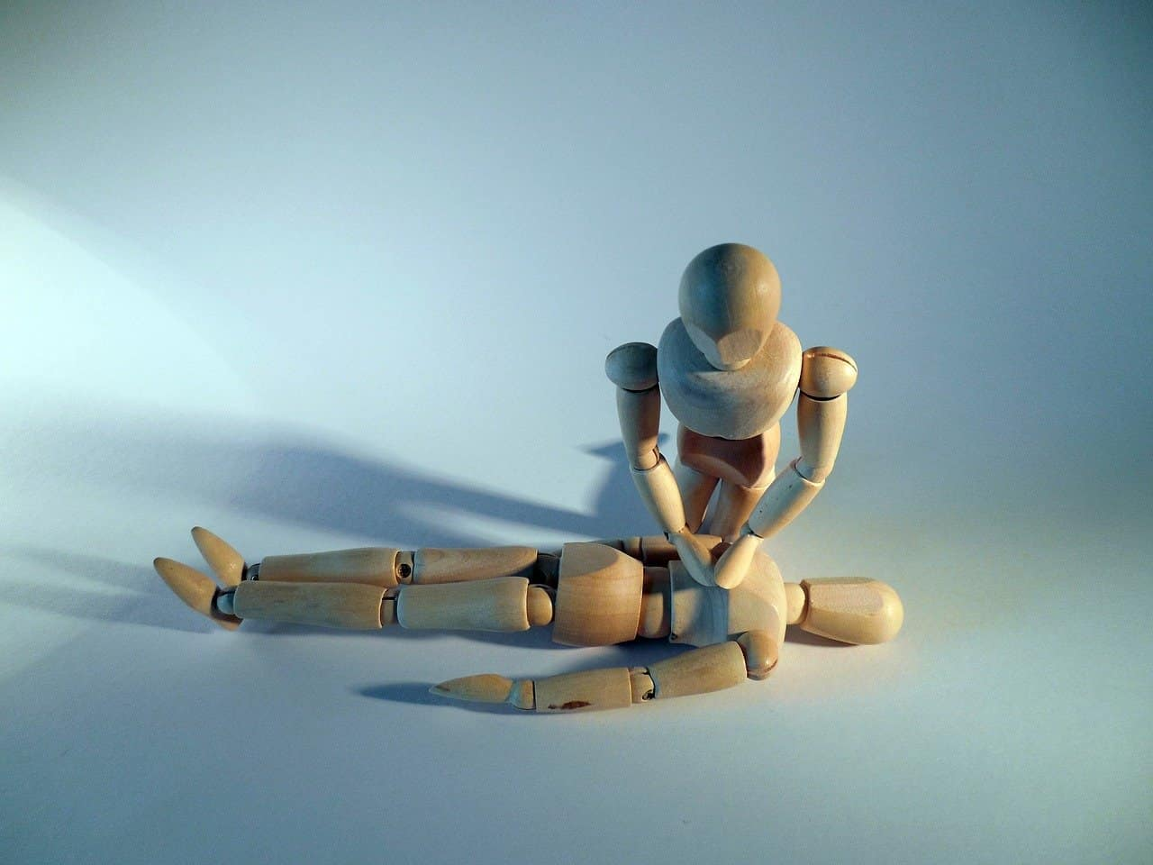 To perform CPR correctly, place one hand on top of the other with the heel of the bottom hand on the center of the chest.