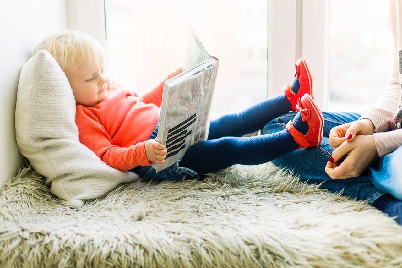 Reading out loud to children helps to encourage their own reading enthusiasm and ability.
