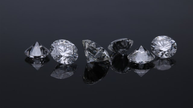 Diamonds are made from carbon under the surface of the Earth.