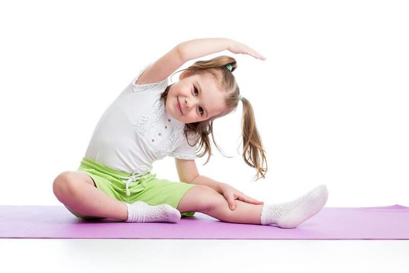 kid doing yoga pose