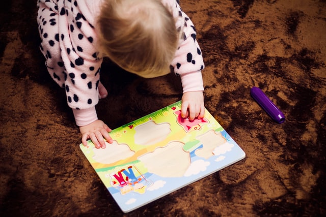 Playing games and encouraging children to point out things they know is a great way to encourage language development.