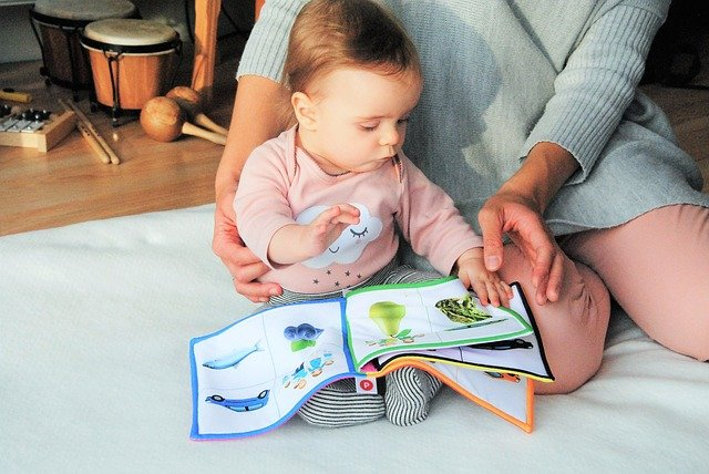 Your baby will love reading with you at this age.