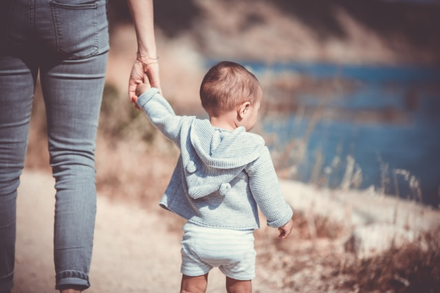 Walking is on the 14-month-old milestones checklist, but don't worry if your toddler isn't quite there yet.