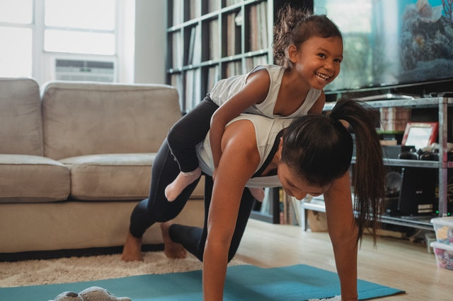 Why not try out a mommy and baby yoga class?