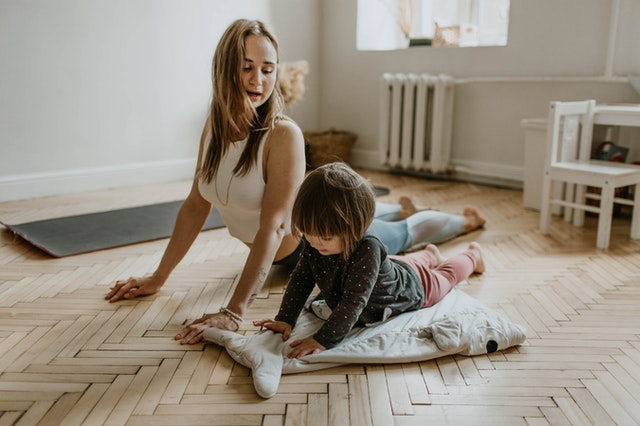 Both mom and baby will feel the benefits of a postpartum yoga class.
