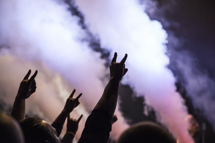 A crowd is often inspired whilst enjoying a rock concert.
