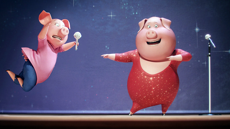 Two characters from the movie Sing performing on stage.