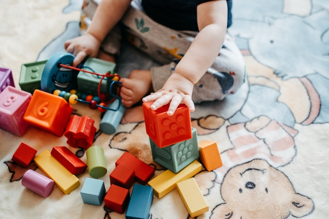 Babies learn through play. Playing games with your 6-month-old baby will help with their cognitive and physical development.