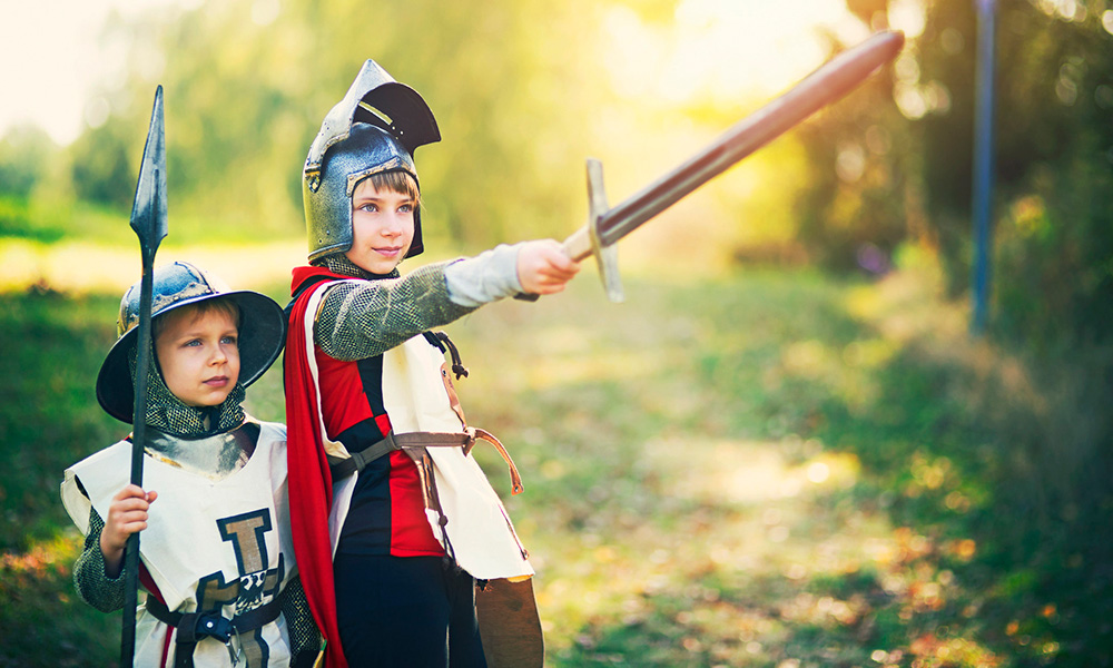 Two young knights prepare for battle.