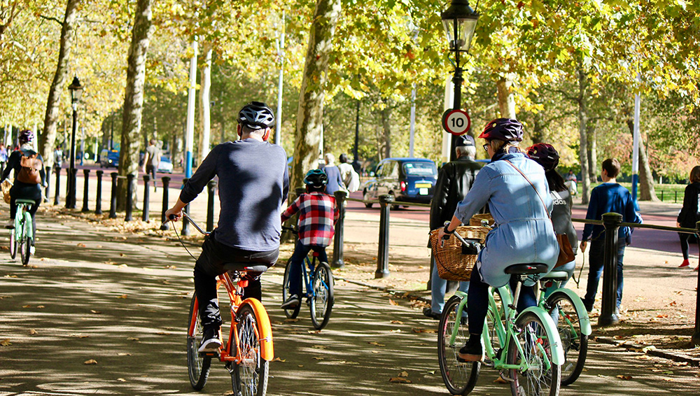 Cycling through Hyde Park on the Secret London Bike Tour.