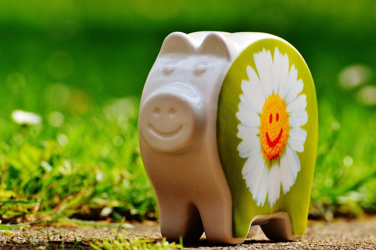 Image of porcelain pig ornament with sunflower painted on it.