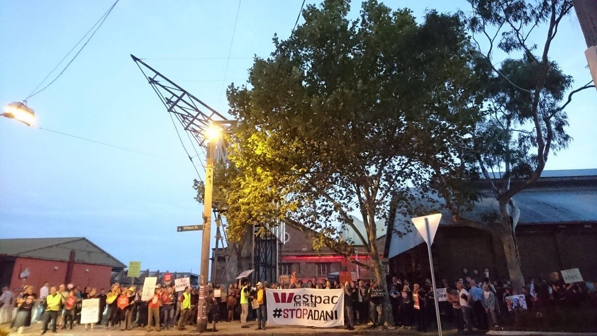 Image of people protesting: Westpac it's time to #STOPADANI