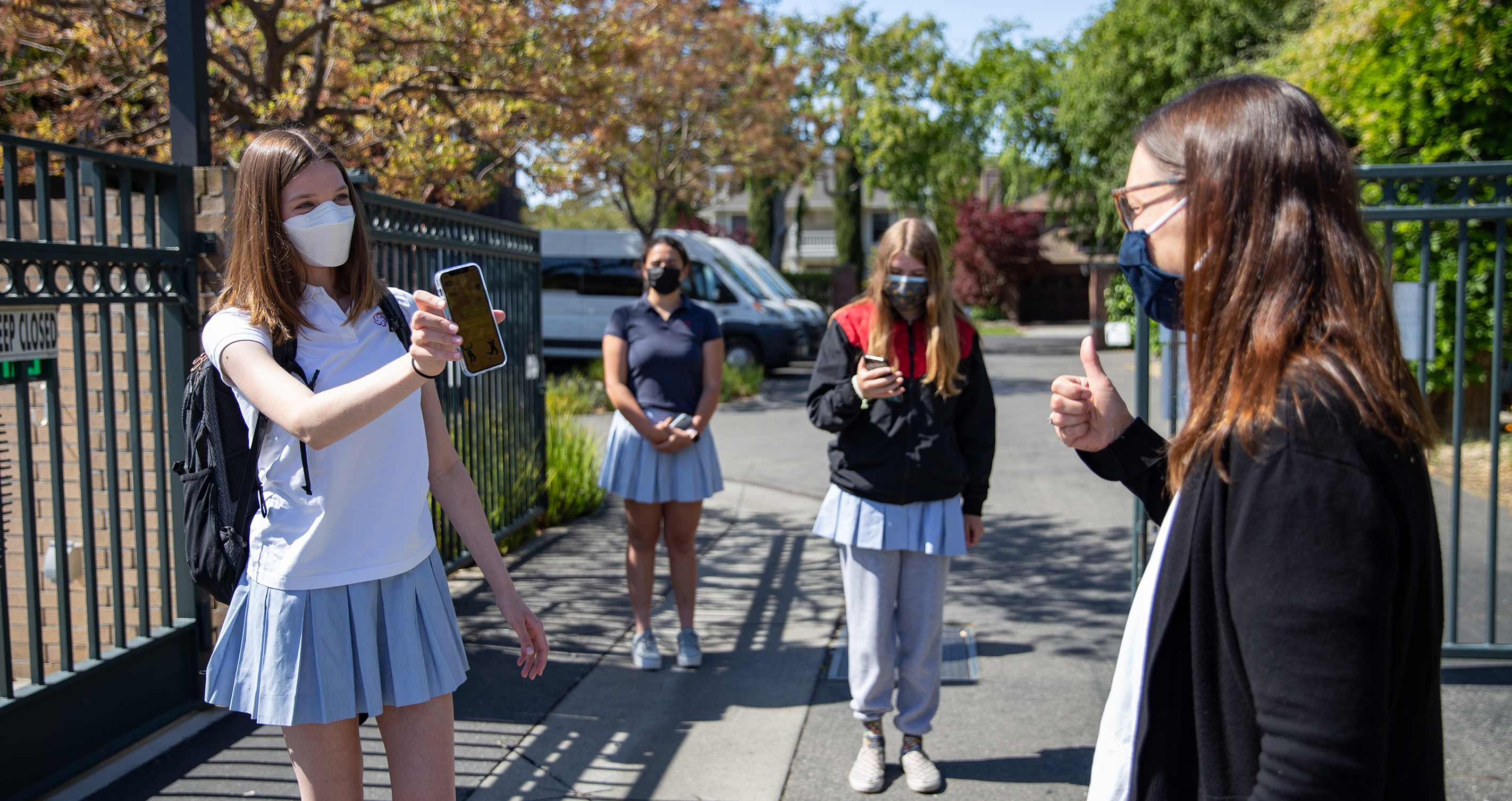 Castilleja students return to school using the CVKey health screening app.