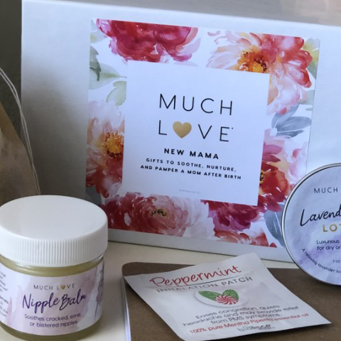 Much Love New Mama gift box with images of products (a jar of balm, lotion, peppermint patch, etc).