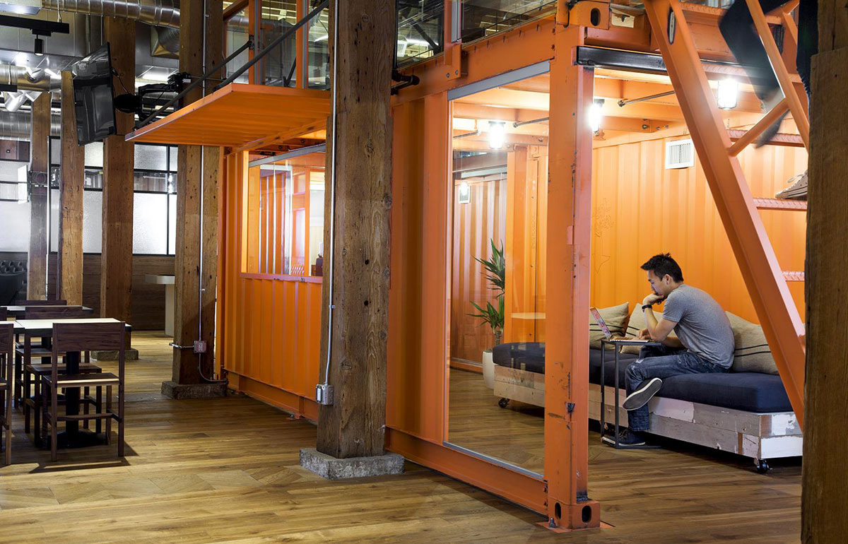 Orange metal container with bench at Github's office