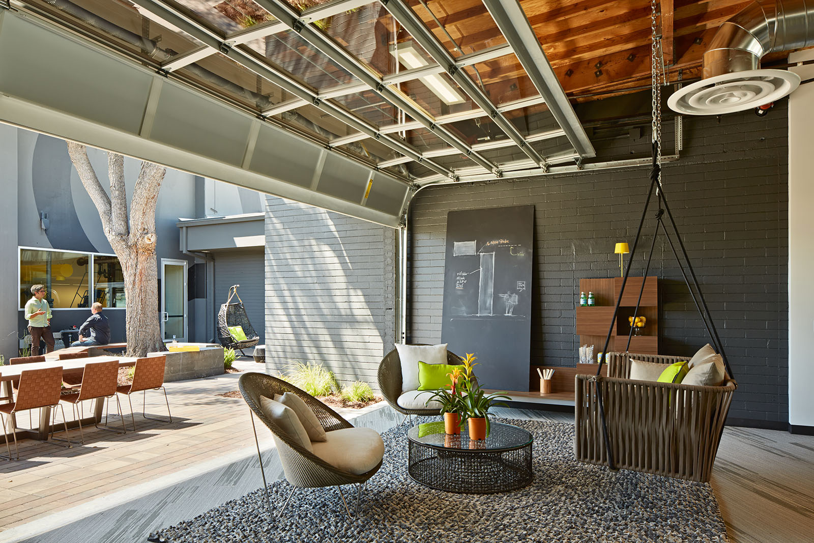 One Workplace - Outdoor office with open garage breakout area