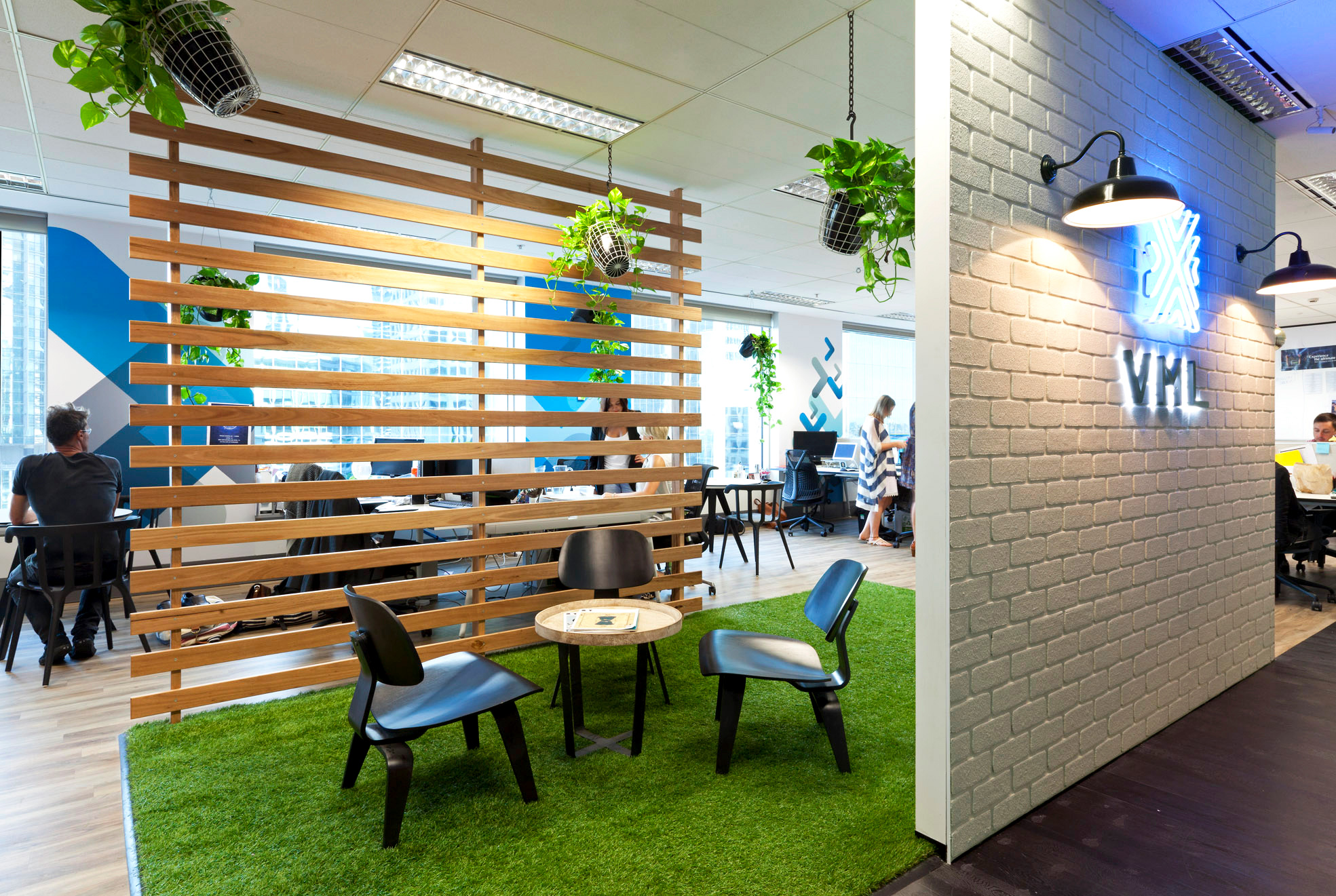 Meeting space with astroturf floors in the office