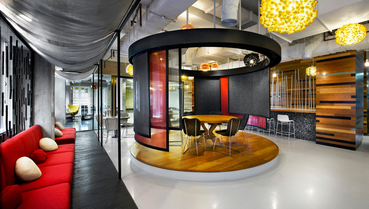 Elevated wood platform breakout space at Ogilvy's Jakarta office