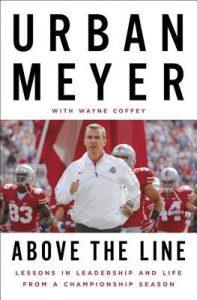 Urban Meyer running onto the Ohio State University football field