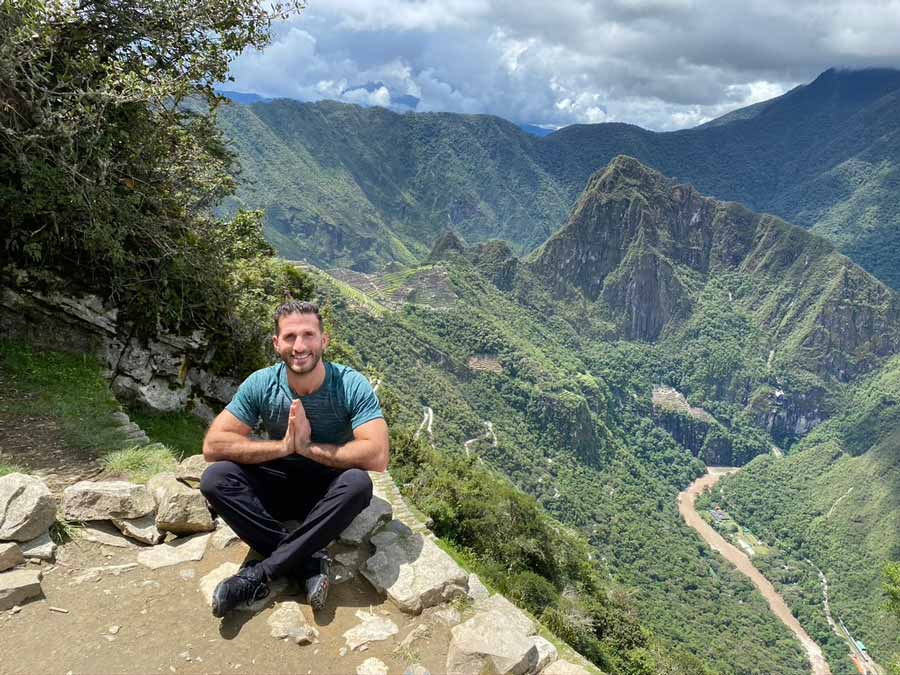 SOUND Sparkling Tea co-founder Salim Najjar smiling and sitting cross-legged on a mountain [Unioncrate]