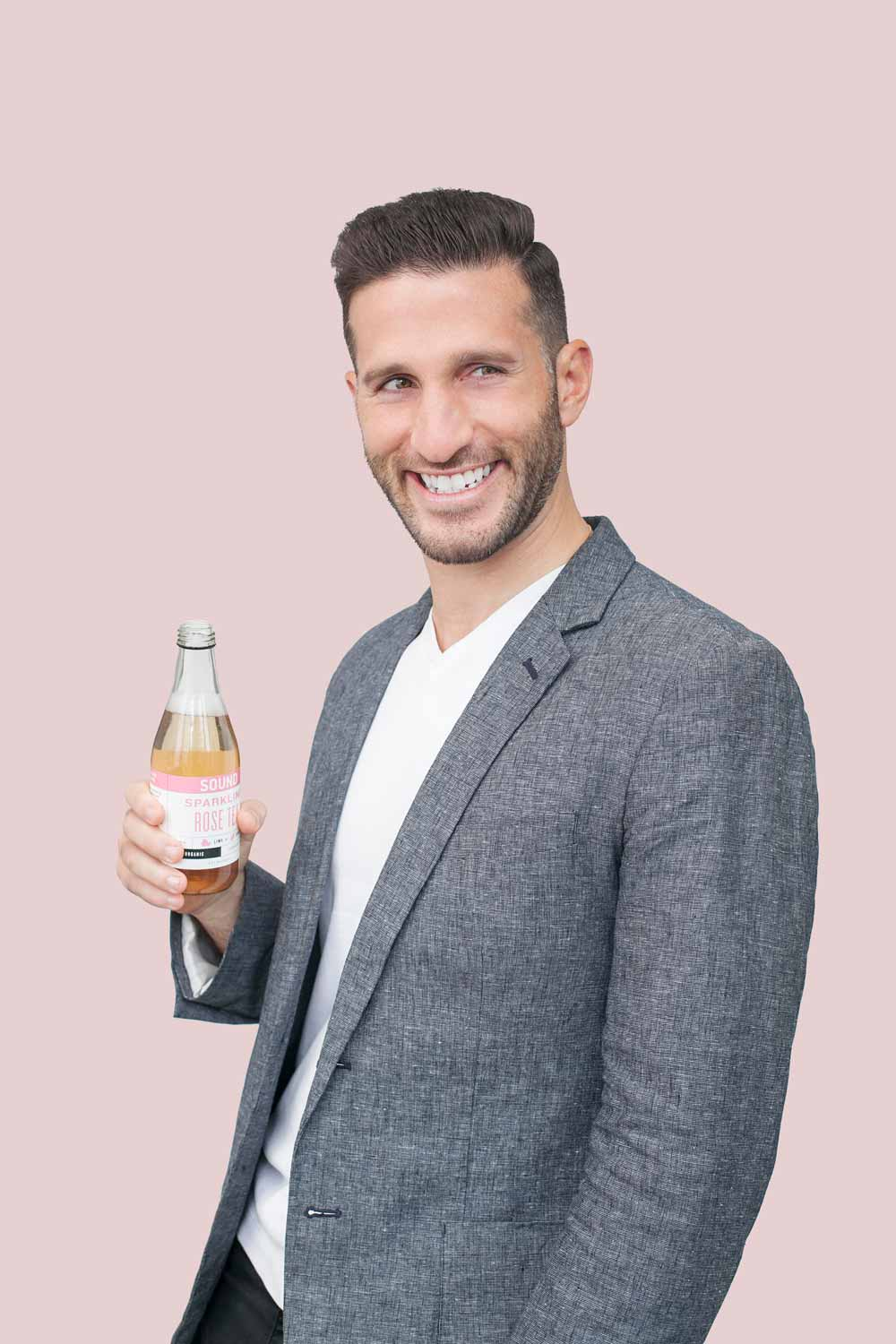 SOUND Sparkling Tea co-founder Salim Najjar smiling next to his product [Unioncrate]