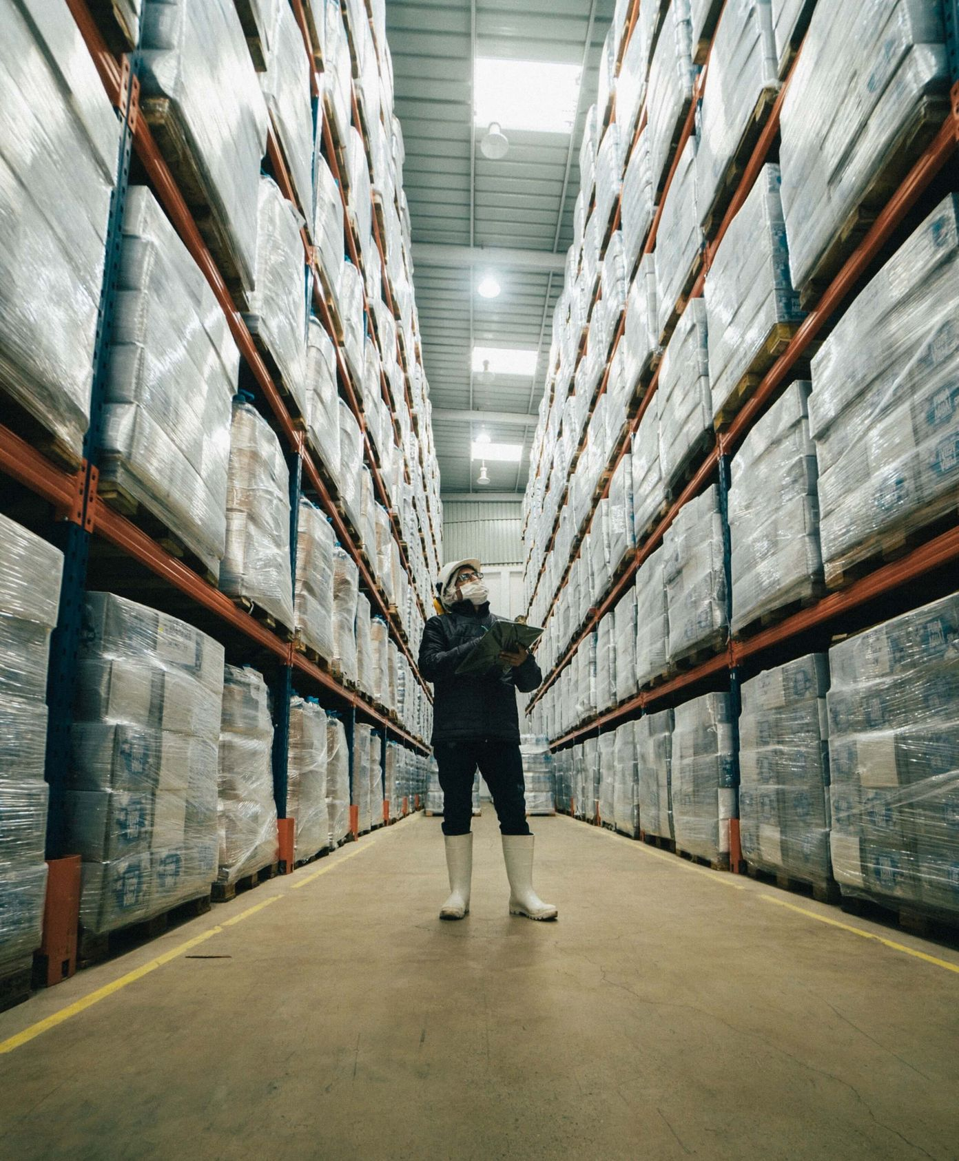 A warehouse employee evaluates safety stock inventory [Unioncrate]