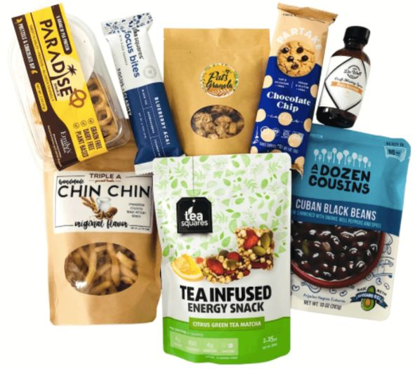 Selection of healthy snacks, including Tea Squares, Partake, and A Dozen Cousins [Unioncrate]