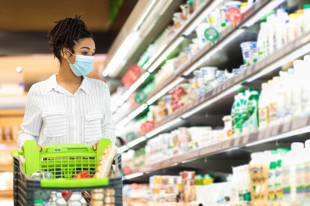 A consumer browses the dairy aisle at a brick-and-mortar grocer [Unioncrate]