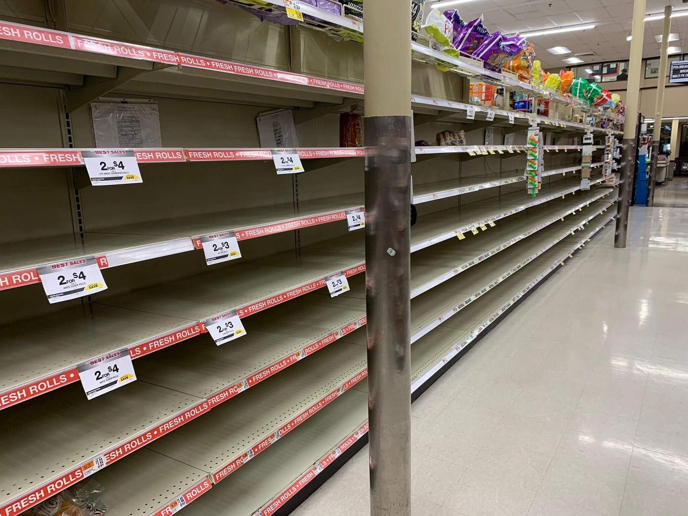 Empty shelves at a grocery store during the height of Covid panic buying, March 2020 [Unioncrate]