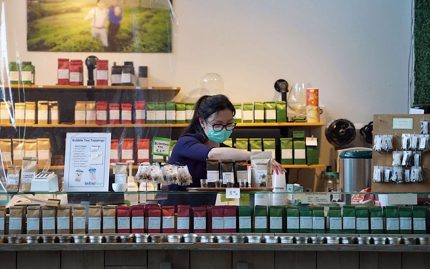 A tea shop employee stocking inventory [Unioncrate]