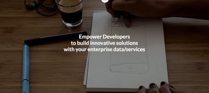 Someone drawing a smartphone with text about empowering developers [Unioncrate]