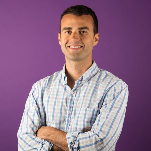 Spindrift Supply Chain Director Eric Fenstermaker smiling with crossed arms against purple background [Unioncrate]