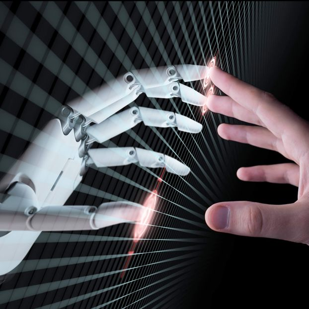 A robotic and a human hand reaching for one another, representing AI and human collaboration [Unioncrate]
