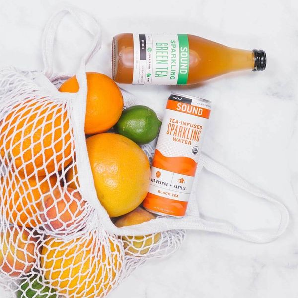 A net bag of oranges and limes, which constitute the Bill of Materials for SOUND Sparkling Tea [Unioncrate]