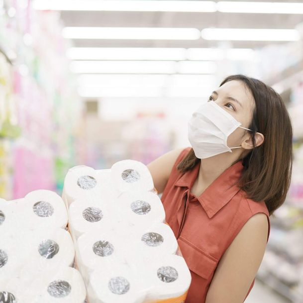A shopper carrying rolls of toilet paper in 2020 during a surge in pandemic-driven demand [Unioncrate]