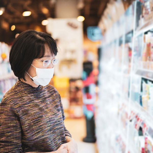 Masked shopper looking at health and beauty CPG products at a retail location [Unioncrate]