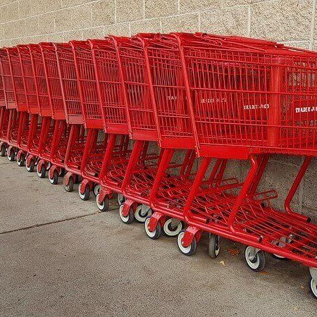 A stacked row of bright red shopping carts [Unioncrate]