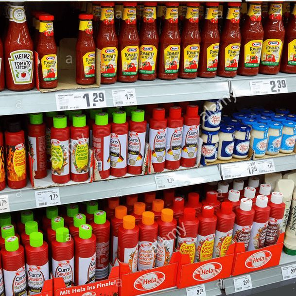 Rows of ketchup, curry-flavored ketchup, and mayonnaise at a brick-and-mortar grocery retailer [Unioncrate]