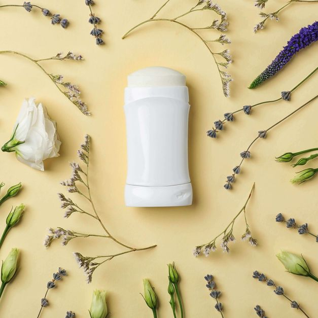Stick of deodorant surrounded by flowers, representing the deodorant category for Unioncrate's CPG Year In Review