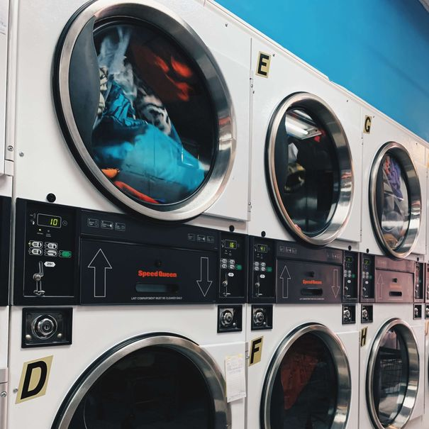 Rows of washers and dryers, representing the laundry care category for Unioncrate's CPG Year In Review