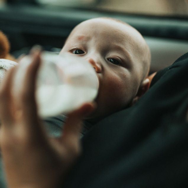 A baby drinking formula from a bottle, representing the baby feeding supplies category for Unioncrate's CPG Year In Review