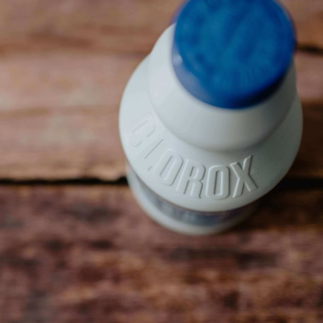 Clorox bottle with blue cap on a wood table, representing the bleach category for Unioncrate's CPG Year In Review