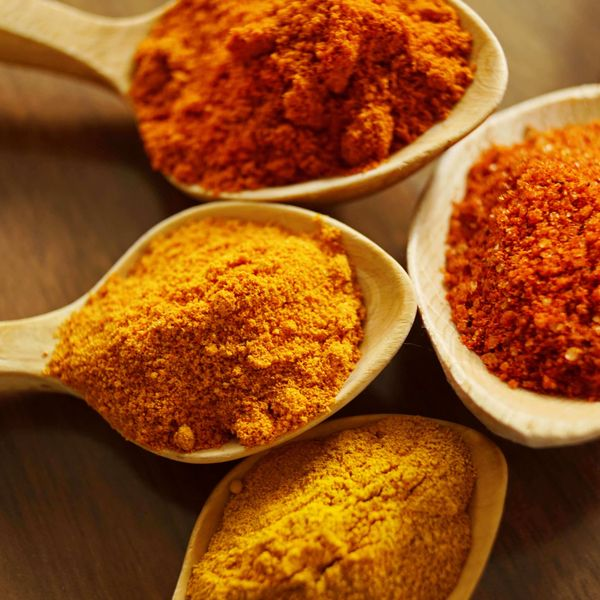 Red and orange spices in wooden spoons, representing the herbs and spices category for Unioncrate's CPG Year In Review