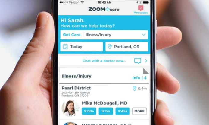 image of someone holding a mobile phone with the ZOOM+Care app open