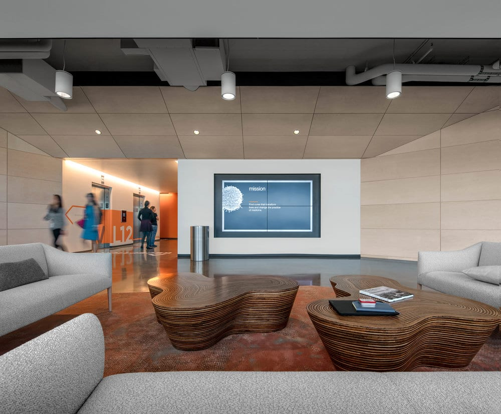 Tech-fitted collaboration areas are nestled throughout the office's nine floors. Image courtesy of Bill Timmerman.