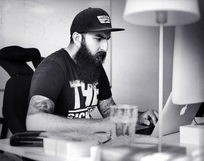 Developer working at a desk on a laptop