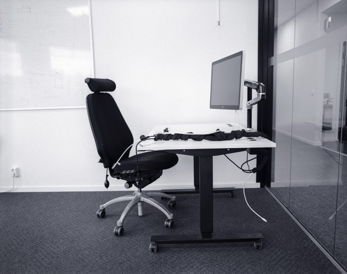 Workspace with an office chair and a big monitor